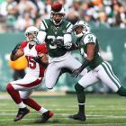Jets safety LaRon Landry jumps in front of WR Michael Floyd to pick off Cardinals QB Ryan Lindley.