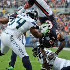 Bears receiver Earl Bennett somehow held on to this touchdown catch against the Seahawks. It wasn't enough for Chicago, though, as it fell 23-17.