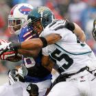 Jacksonville's Dwight Lowery wraps up Bills running back C.J. Spiller. Buffalo won the game, 34-18, and Spiller finished with 77 yards on the ground.