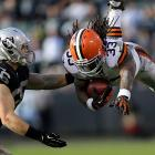 Running back Trent Richardson leaps right in front of Oakland linebacker Miles Burris. Richardson scored his seventh touchdown of the season as the Browns downed the Raiders 20-17.