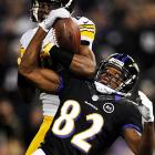 Ravens wideout Torrey Smith and Steelers cornerback Cortez battle for a pass that wound up being incomplete. Pittsburgh ended up winning the game 23-20, handing Baltimore just its third loss.