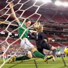 Ireland's Megan Campbell and goalkeeper Emma Byrne try in vain to stop a shot from Megan Rapinoe of the U.S. from going in. The Americans won the friendly, 2-0.