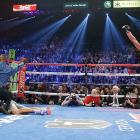 Juan Manuel Marquez celebrates after having just knocked out Manny Pacquiao in the sixth round in Las Vegas. In what was their fourth meeting in the ring, Marquez defeated Pacquiao for the first time.