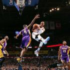 Russell Westbrook makes an acrobatic pass against the Lakers on Dec. 7. The Oklahoma City star had 33 points -- 27 of them in the first half -- and eight rebounds as Los Angeles fell 114-108.