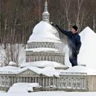 As the fiscal cliff looms, a workman in Lichtenstein purdies up the Capitol Building, where sage lawmakers have produced a blizzard of threats and invective. In other news from Washington, President Obama called for an end to the NHL lockout after officials from both sides in the dispute started pouting and refusing to speak to each other.