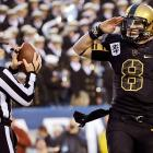 Army strong: The Black Knights QB salutes stoically as he goes down with his ship in a 17-13 loss to Navy.
