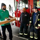 """""""The SUBWAY Guy"""" (left) and Patriots linebacker Mayo (fitting last name for tackling sandwiches) paid a surprise visit to the Boston Fire Department. The chief (in the window of the truck) was clearly delighted."""