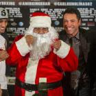 Golden Boy Promotions president Oscar De La Hoya (left) and a couple of pugs named Khan and Molina (right) introduced Manny Pacquaio's next opponent: North Pole heavyweight Kris Krinkle.