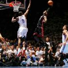 LeBron James goes up for a slam against the Thunder during the NBA Finals. James and the Heat won the championship in five games.