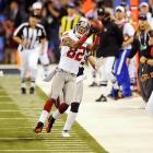 Mario Manningham hauls in a crucial fourth-quarter pass to set the Giants up for the winning score in the Super Bowl.