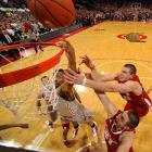 Ohio State's Lenzelle Smith, Jr. (32) battles for a rebound with Wisconsin's Jared Berggren (40) and Josh Gasser (21) in the Badgers' comeback win at the Buckeyes.