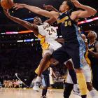 Kobe Bryant gets denied by Nuggets center JaVale McGee during a Denver-Los Angeles Staples Center showdown. The Lakers won 103-88.