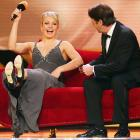 The two-time Olympic biathlon gold medalist kicked up her heels after receiving a Female Athlete of the Year 2012 award at a gala event in Germany's Kurhaus Baden-Baden in Baden-Baden. Not Baden at all.