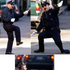Tony Lepore has all the moves while directing traffic at an intersection on Dorrance Street in Providence, R.I., even one for a pow-wow with an oncoming bus.