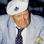 After a nasty negotiation over rights to broadcast Leafs games on radio, Ballard (pictured) awards them to highest bidder CKO, taking them away from CKFH and legendary announcer Foster Hewitt. Ballard then orders the existing radio position moved from its historic gondola spot in Maple Leaf Gardens to a less favorable position in order to make room for luxury boxes. When the Hockey Hall of Fame asks to purchase the original gondola, Ballard instead orders it dumped into an incinerator.