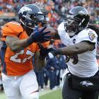 Denver Broncos running back Knowshon Moreno makes a touchdown reception against Baltimore inside linebacker Dannell Ellerbe.