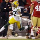 Cornerback Sam Shields returns an interception for a touchdown as 49ers quarterback Colin Kaepernick dives in vain.