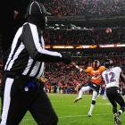 Rahim Moore of the Broncos fails to tip the ball, allowing Jacoby Jones to score a 70-yard, game-tying touchdown with 31 seconds left.
