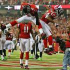Matt Ryan and Jason Snelling celebrate a third-quarter touchdown.