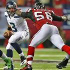 Sean Weatherspoon closes in on Seattle's Russell Wilson, who was as elusive as always.