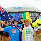 Two fans show off their colors outside Rod Laver Arena.