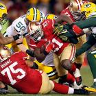 San Francisco 49ers running back Frank Gore gets swarmed by the Green Packers defense during the NFC Divisional playoff matchup in San Francisco. Gore gained 119 yards on the ground with a touchdown, part of the 49ers' 323 yards rushing.