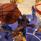 Oklahoma City center Kendrick Perkins reaches for a block on a layup by Kobe Bryant. Bryant's 28 points were not enough as the Thunder prevailed 116-101 in the Jan. 11 matchup of Western Conference foes.