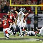Kicker Matt Bryant and the Atlanta Falcons celebrate after a last-minute field goal sent them over the Seattle Seahawks and into the NFC Championship game. After blowing a 20-point lead in the fourth quarter, the Falcons marched down the field to set up a late kick, giving the franchise its first postseason win since the 2004 season.