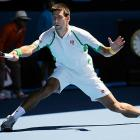 Novak Djokovic stretches for a forehand in his Australian Open first round match against Paul-Henri Mathieu. Djokovic easily advanced, downing Mathieu 6-2, 6-4, 7-5.