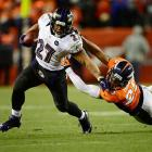 Baltimore Ravens running back Ray Rice fights off Denver Broncos cornerback Chris Harris in the Ravens-Broncos AFC Divisional playoff matchup in Denver. Rice's 131 yards rushing helped lead Baltimore to a 38-35 overtime upset of the top-seeded Broncos.