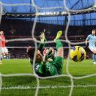 Arsenal goalkeeper Wojciech Szczesny corrals the ball after tipping Edin Dzeko's penalty kick off the post in Arsenal's Barclays Premier League match with Manchester City. Szczesny's save, which came after Arsenal's Laurent Koscielny was sent off for a tackle on Dzeko, preserved a tie that didn't last long as Manchester City carried on to win 2-0.
