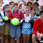 Young fans wait for Australian Bernard Tomic at his practice session. Tomic faces Roger Federer on Saturday night.