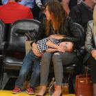 Nothing quite like a restless kid to enhance your basketball viewing experience, as Mrs. Wahlberg can attest as the Lakers battle the Heat at Staples Center.