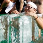 A physical fitness enthusiast on the rocks at Teppozu Inari Shinto Shrine in Tokyo during a winter ritual that combines the endurance challenge of a Tough Mudder ice bath with the conviviality of a cocktail party.