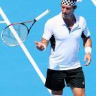 1987 Wimbledon champion Pat Cash takes part in a legends doubles match.
