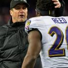 John Harbaugh and Ed Reed congratulate each other for a job well done.