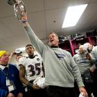 John Harbaugh helped lead a raucous and well-deserved celebration in the locker room.