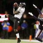 Baltimore's Anquan Boldin makes an off-balance catch in front of New England Patriots cornerback Marquice Cole. The Ravens wide receiver took advantage of a diminished Patriots secondary to score two touchdowns in the fourth quarter to ice the Patriots.
