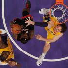 Miami Heat small forward LeBron James goes up for a layup against Los Angeles Lakers power forward Pau Gasol in a Jan. 19 game at the Staples Center. James' 39 points paced the Heat to a 99-90 victory, dropping the Lakers five games under .500.