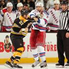 Distance did not make the hearts grow fonder between Boston Bruins left winger Shawn Thornton and New York Rangers center Michael Rupp. On the first day of the regular season, the two went at it in the second period of the Bruins' 3-1 win.