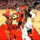 Louisville's Montrezl Harrell battles for a rebound with a Syracuse player in the Jan. 19 matchup of the top-10 ranked teams. The Orange got the better of Dieng's Cardinals, knocking off top-ranked Louisville 70-68.