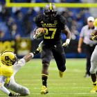 Green already looks like a professional running back, and he was unstoppable against high school competition. Despite sitting out the second half of a number of blowouts, the Richmond, Va., native still rushed for 1,350 yards and 21 touchdowns as a senior. Green committed to Michigan on Jan. 26.