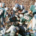 Dallas Cowboys running back Calvin Hill attempts to leap over the pile but gets tackled by the Dolphins defense. The Cowboys dominated on the ground, rushing for a Super Bowl-record 252 yards en route to a 24-3 victory.