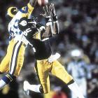 Pittsburgh Steelers wide receiver John Stallworth hauls in a pass from Terry Bradshaw just beyond the outstretched fingers of Los Angeles Rams cornerback Rod Perry. Stallworth took the pass 73 yards to the end zone to give the Steelers the lead for good in their 31-19 win.