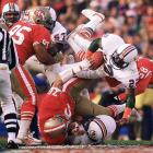 Miami Dolphins running back Tony Nathan dives on top the San Francisco 49ers defense. Nathan had limited success running the ball in the 38-16 loss, gaining just 18 yards on the ground. He did pick up 83 receiving yards on 10 catches.