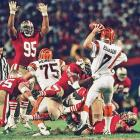 San Francisco 49ers defensive tackle Michael Carter tugs at Boomer Esiason as the Cincinnati quarterback attempts to pass. The 49ers defense limited Esiason to just 11-of-25 passing and 144 yards with no touchdowns and one interception in San Francisco's 20-16 win.