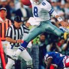 Troy Aikman hurdles a Buffalo Bills defender on a scramble. The Dallas Cowboys quarterback was named Super Bowl MVP after completing 22 of 30 passes for 273 yards and four touchdowns. He also rushed for 28 yards in the 52-17 romp.