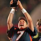 John Elway raises the Lombardi Trophy after the Denver Broncos' 31-24 triumph over the Green Bay Packers. After 15 seasons in the league, the illustrious quarterback finally won his first Super Bowl.