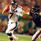 Denver Broncos quarterback John Elway stiff arms an Atlanta Falcons defender on a scramble. The 38-year-old Elway became the oldest player to be named Super Bowl MVP, throwing for 336 yards and a touchdown and rushing for another score in Denver's 34-19 win, the final game of Elway's career.