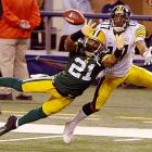 Green Bay Packers cornerback Charles Woodson breaks up a pass intended for Pittsburgh Steelers wide receiver Mike Wallace. Woodson broke his collarbone on the play and did not return. The Packers won 31-25.